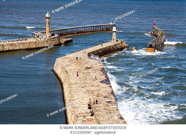 People Walking on the Piers at Whitby Yorkshire Coast England