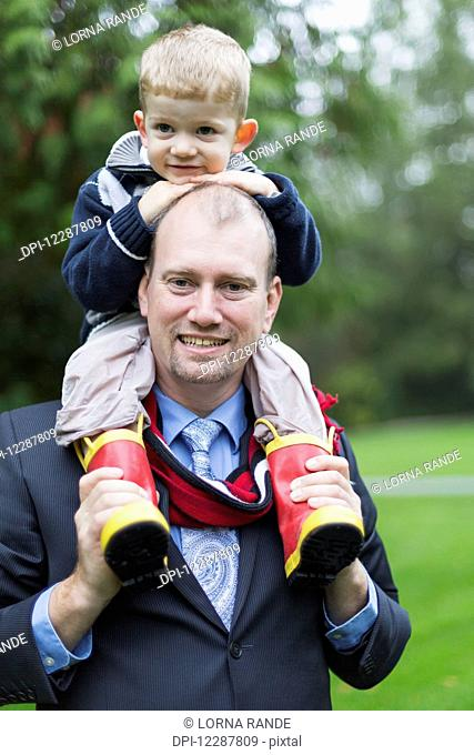 Portrait of a father and son in Bear Creek Park; Surrey, British Columbia, Canada