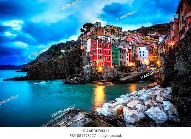 early morning twilight hours in riomaggiore. Riomaggiore is a small colorful town in Cinque Terre, Italy. Taken during winter season
