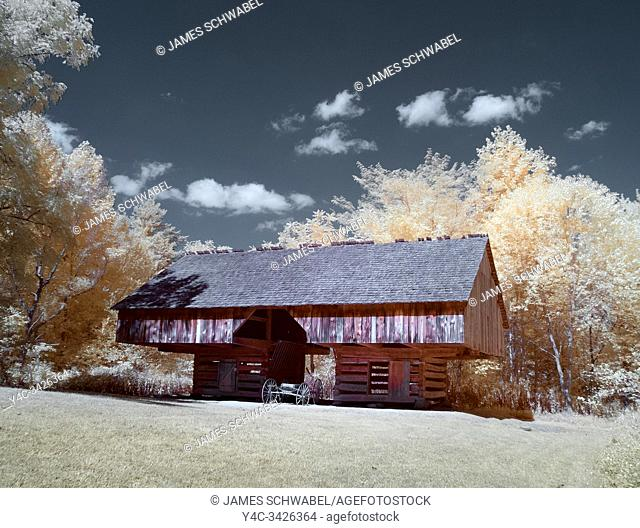 Infrared red false color photography of Cantilever barn at Tipton house in Cades Cove in the Great Smoky Mountains National Park Tennessee