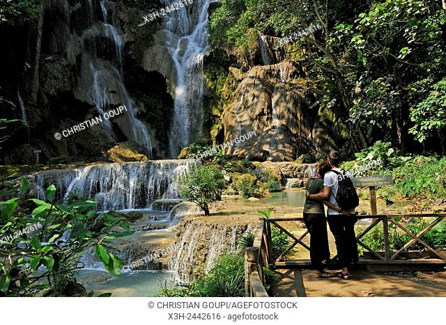 couple admiring Kuang Si waterfalls, nearby Luang Prabang, Laos, Southeast Asia