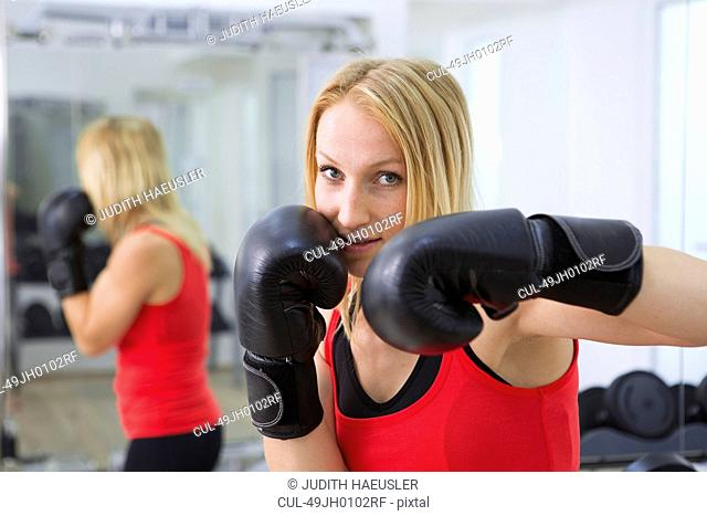 Boxer training with gloves in gym