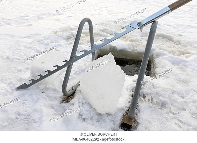 ice saw with hole in the ice and ladder for taking a bath