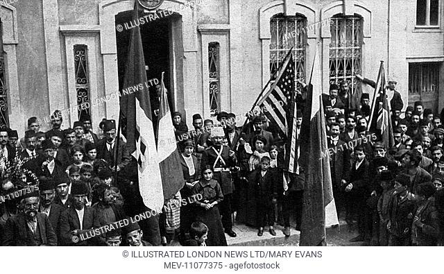 Flags of the Allies and that of the United States (held by a Russian officer) displayed outside the governor's house. Trebizond