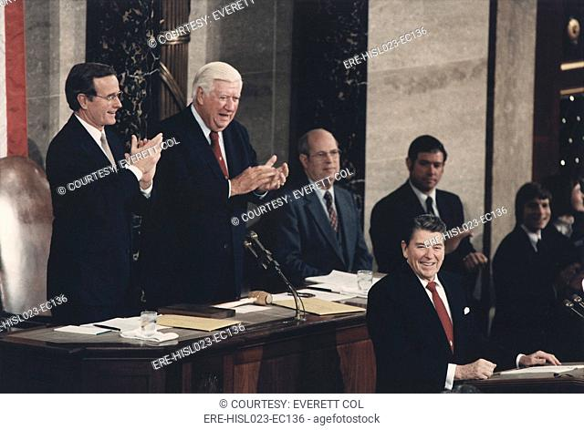 President Reagan receives a standing ovation during his the State of the Union Address to Congress. Behind him are Vice President George Bush left and Speaker...