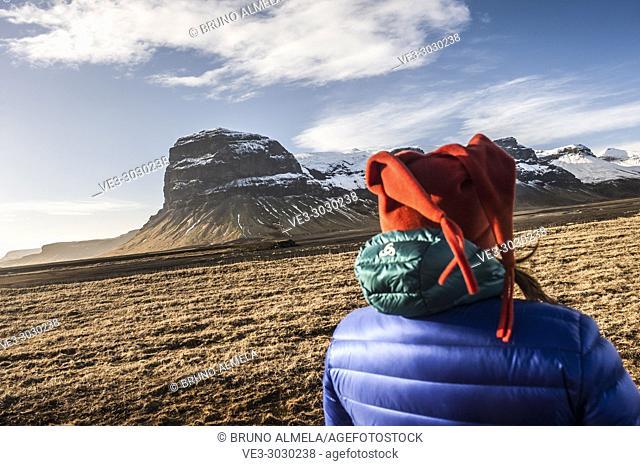 Enjoying Lómagnúpur view, a cliffs that towers over Björninn Mountain, west of the Núpsvötn Lakes in Skeiðarársandur (region of Suðurland, Iceland)