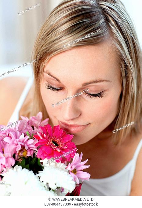 Beautiful woman smelling a bunch of flowers