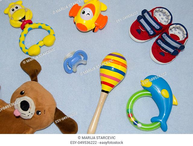 Table top view decoration baby shoes and toys. Flat lay, copy space