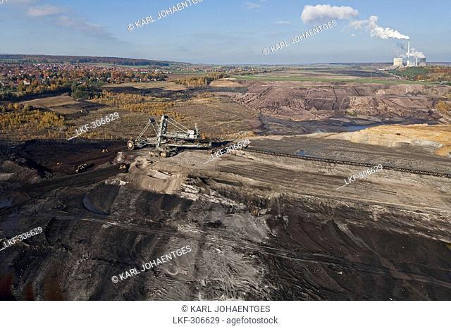 Aerial view of a bucket-wheel excavator with conveyor belt in for open-pit lignite mining, brown coal, Schoeningen, Lower Saxony, Germany