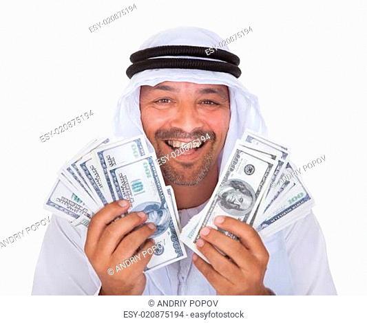 Portrait Of Mature Arab Man Holding Dollars