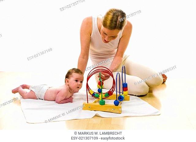 Mama playling with newborn baby