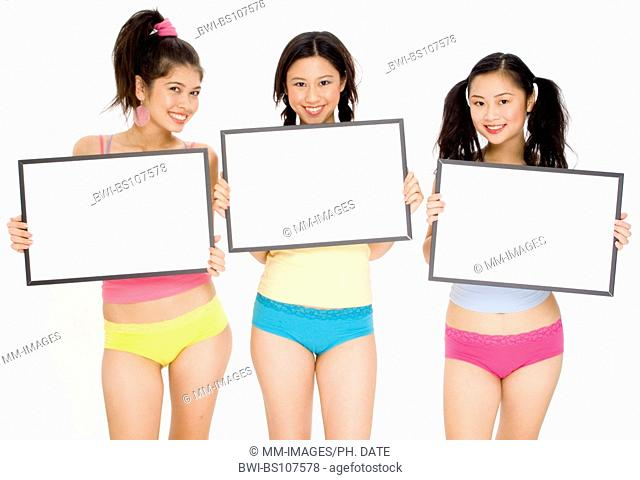 Three pretty asian girls holding blank signs