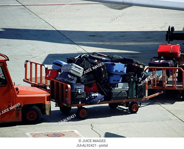 Baggage carts on airport tarmac, Tenerife, Canary Islands, Spain