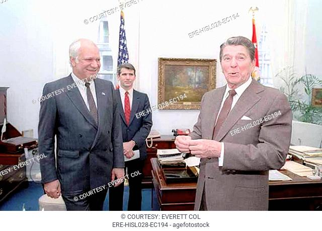 President Reagan in Robert McFarlane's office with Adolfo Calero a Nicaraguan Democratic Resistance Contra leader and Oliver North in background