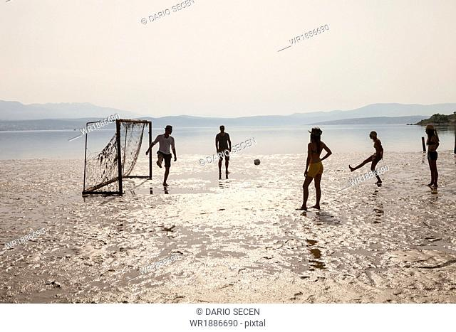 Croatia, Young people on beach playing soccer