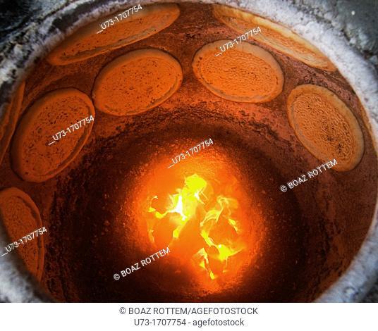 Freshly baked Naan bread in a Tandoor oven in Xinjiang, China