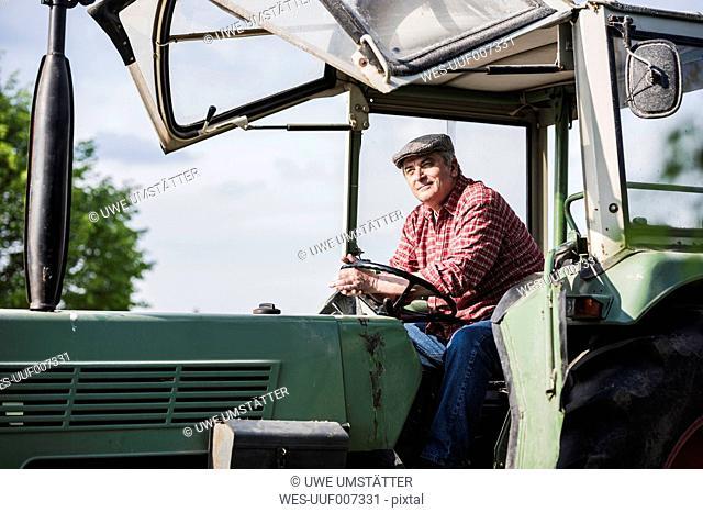 Farmer sitting in tractor