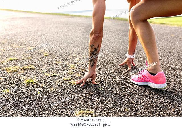 Female runner preparing for start
