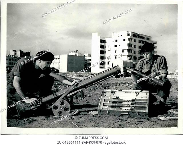 Nov. 11, 1956 - Latest scenes from port said. Russian Rocket launcher captured from Egyptians: photo shows Pete. Kenneth Oxalic from crew and cpl