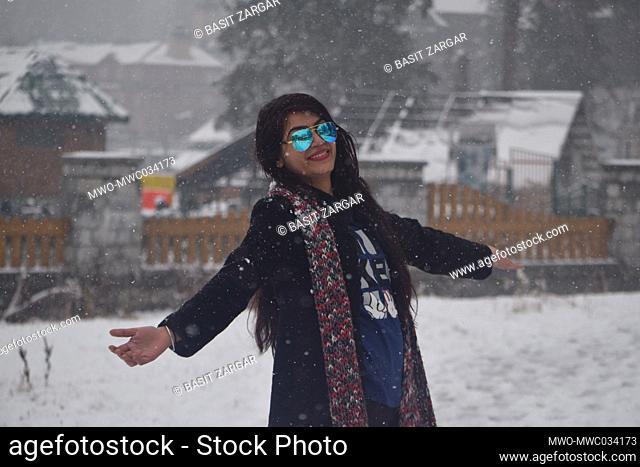 Kashmir, 15th November 2020. A woman enjoying the snowfall. A fresh spell of snowfall was observed in the higher reaches of Jammu and Kashmir on Saturday