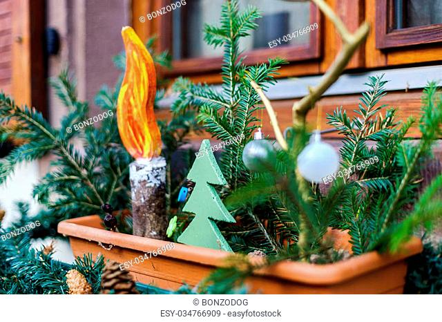 Beautiful Christmas decoration elements on street of alsacien village