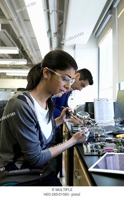 Engineer assembling electronics