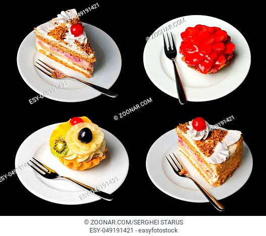 Cakes on plates with forks isolated on black