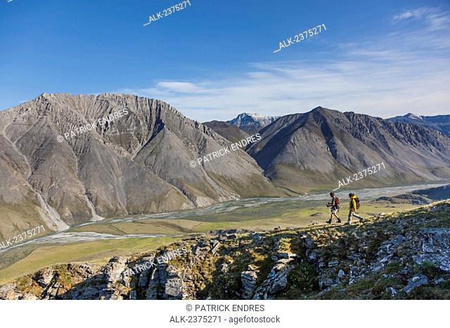 Hikers in the mountains bordering the Marsh Fork of the Canning river in the Arctic National Wildlife Refuge, Brooks range mountains, Alaska