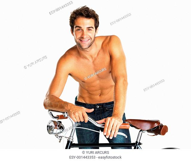Attractive shirtless man standing with his bicycle