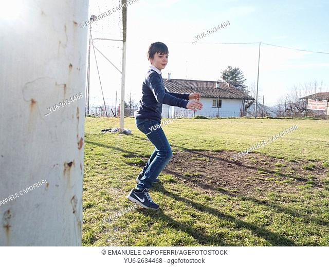 Child plays football in the door
