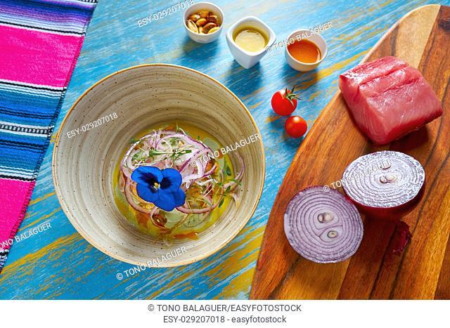 Fish ceviche latin preuvian recipe on bowl with pansy flower