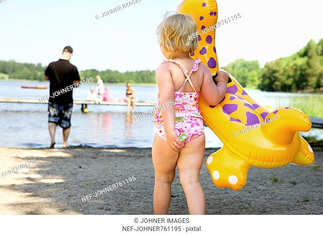 Girl with a toy on the beach, Sweden