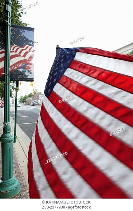 American flag blowing in the breeze on the main square in Noblesville, Indiana, IN, USA,