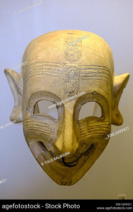 Grinning mask, from S, Sperate, clay. 6th-5th cent. BCE, Cagliari, Museo archeologico nazionale, The Coliseum , Rome, Lazio, Italy ,