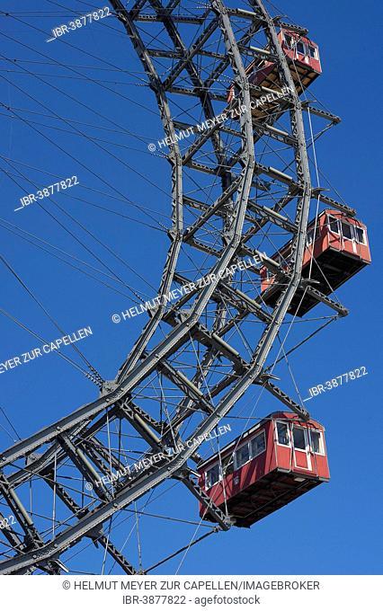 Three cabins of the Wiener Riesenrad ferris wheel against a blue sky at the Prater, Vienna, Austria