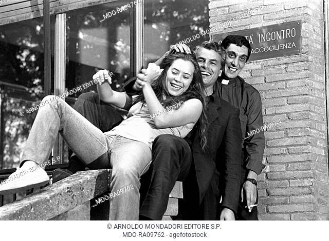 Italian actors Flavio Bucci, Michele Placido and Barbara De Rossi smiling on the set of TV show La piovra. 14th September 1983