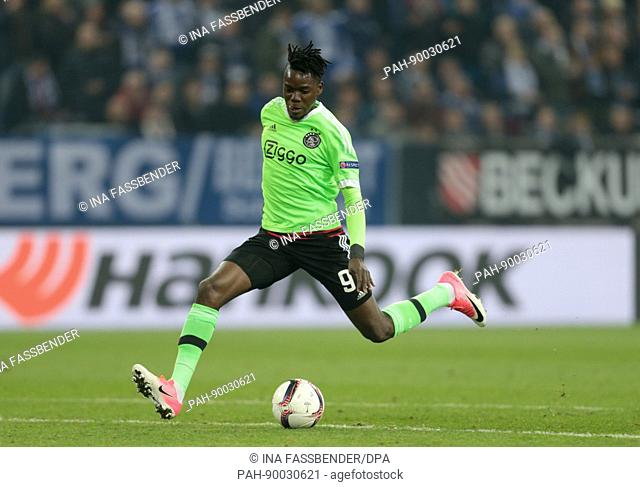 Ajax's Bertrand Traore runs with the ball during the second leg of the UEFA Europa League quarter final tie between FC Schalke 04 and AFC Ajax in the Veltins...