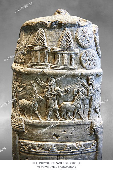 Stone Stele depicting a ceremonial procession of Babylonian Gods. Circa 1186-1172 BC excavated from Susa where it had been taken as a spoil of war