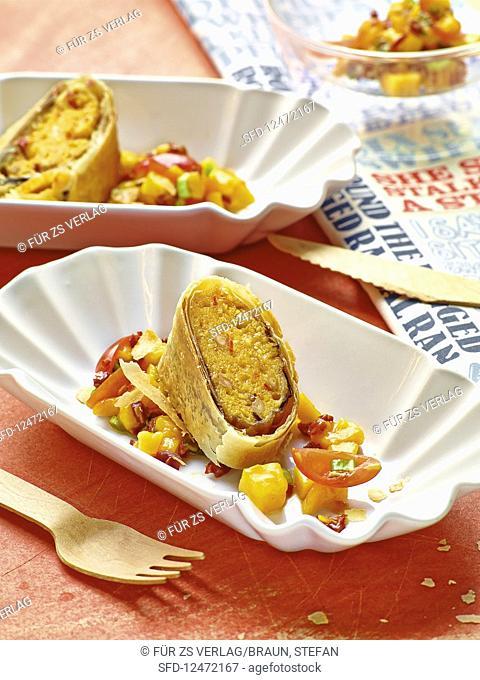 Aubergine polenta strudel with a tomato and mango salad