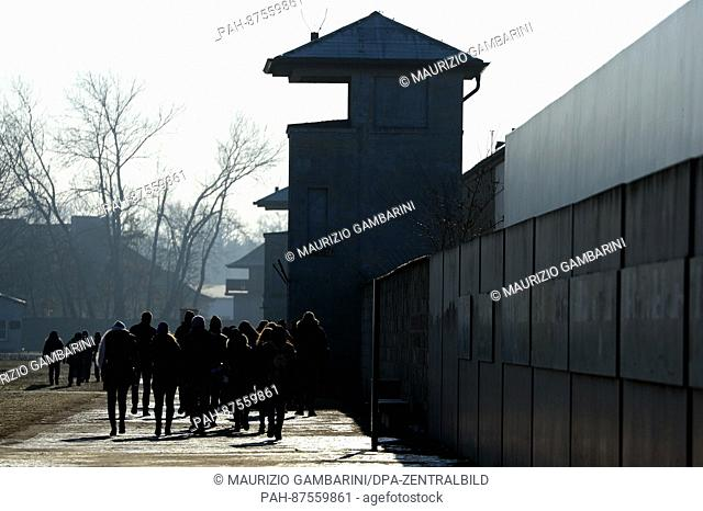 Visitors go across the grounds at the Sachsenhausen concentration camp in Oranienburg, Germany, 27 January 2017. The Day of Remembrance for the victims of...