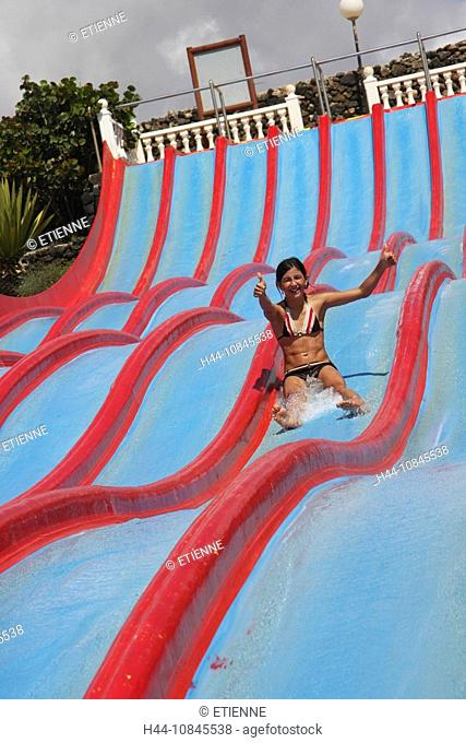 Lanzarote island, Spain, Europe, Canary islands, Costa Teguise, Aquapark, water park, water slide, sliding, girl, Outd