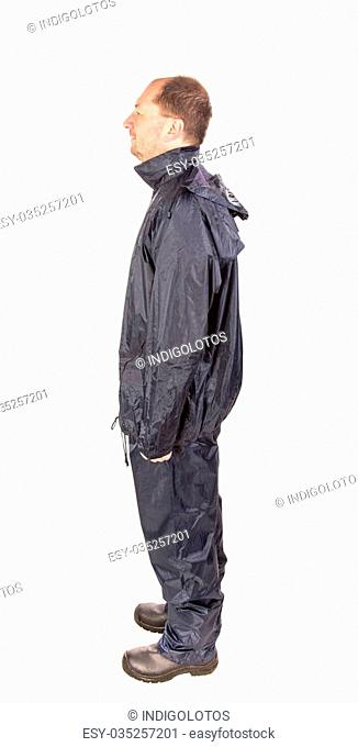 Worker in black workwear. Isolated on a white background
