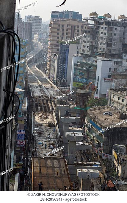 DHAKA, BANGLADESH - APRIL 27 : Bangladeshi worker work on flyover construction where they are not using any safety equipment in Dhaka, Bangladesh on April 27