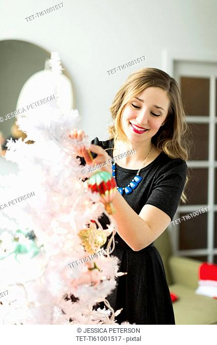 Young woman holding Christmas ornament