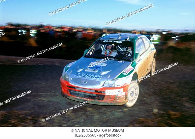 2002 Hyundai Accent WRC on 2002 Network Q rally, Kankkunen. Artist: Unknown