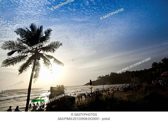 Tourists on the beach, Kovalam, Kerala, India