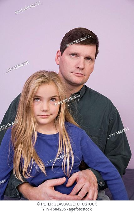 Young blonde girl with her father
