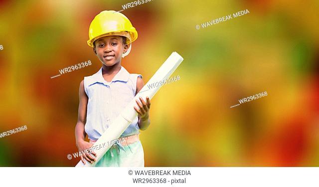 Boy pretending as architect holding blueprint over bokeh