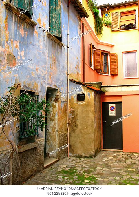 A colorfully painted courtyard in Rimini