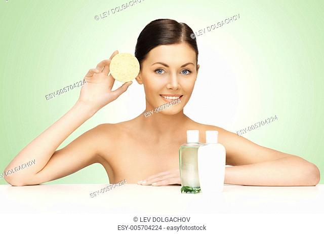 picture of woman with sponge and cosmetic bottles